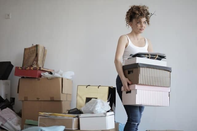 A woman carrying boxes.