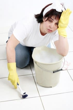 lady cleaning her dirty tile and grout