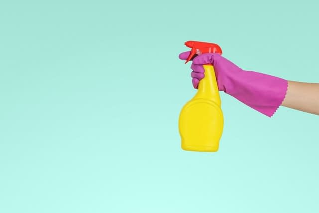 A cleaning product in a yellow spray bottle