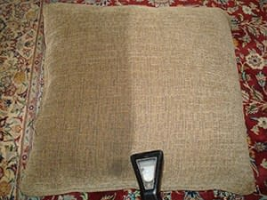 very dirty cushion cleaned by upholstery cleaning company