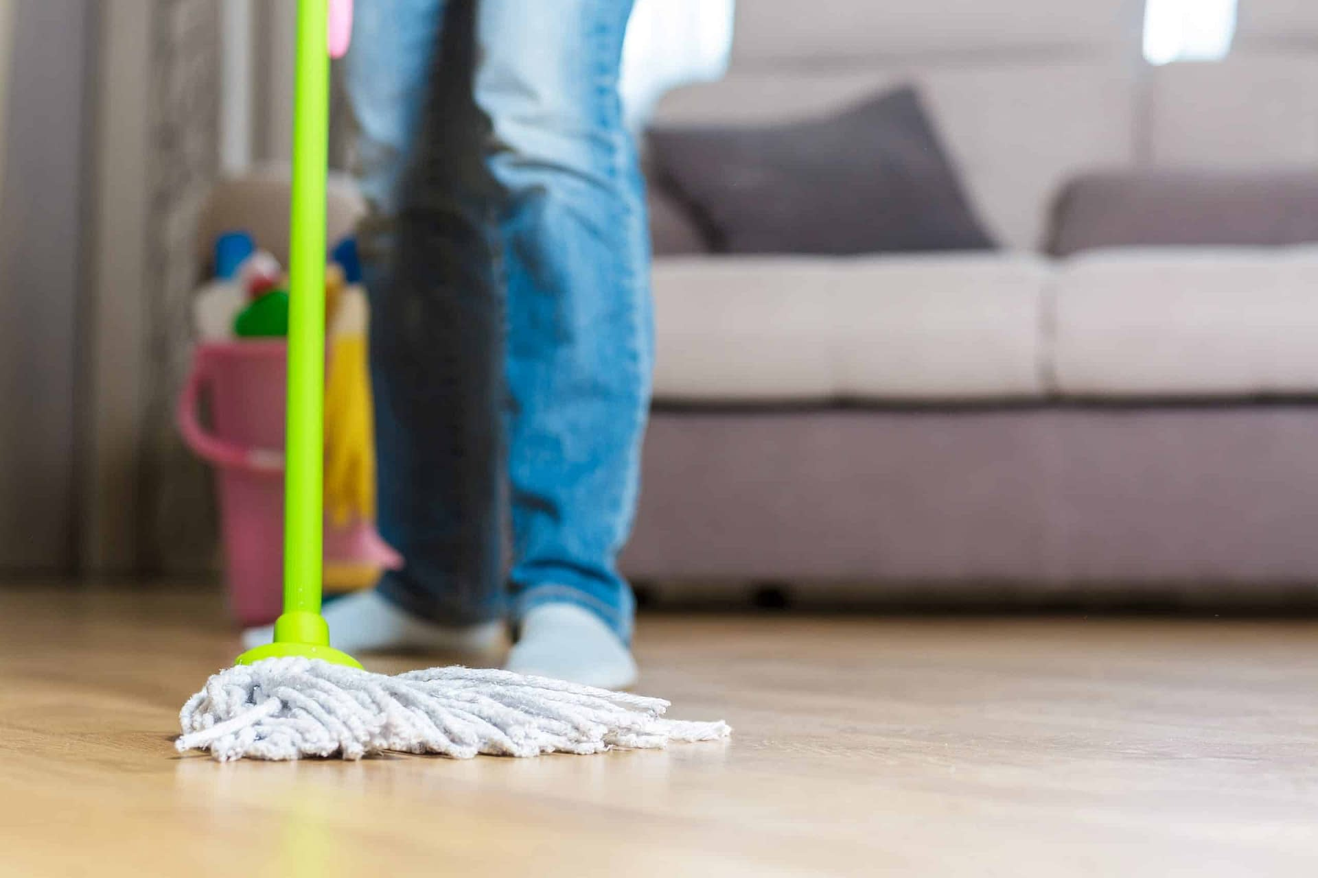 cleaning wood floor with a mop