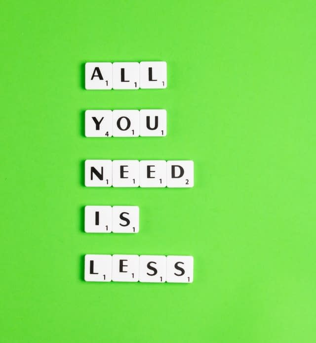 An eco-friendly sign saying all you need is less